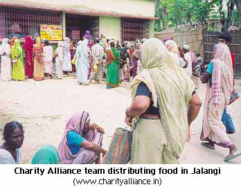 Charity Alliance team distributing food in Jalangi